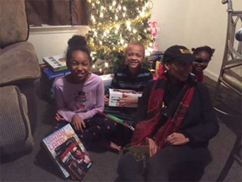 Christmas Gift Recipients Happy to Open their Christmas Gifts