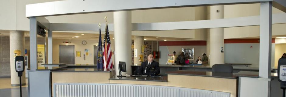 Security and information desk in lobby of Bonnell Building at Community College of Philadelphia.